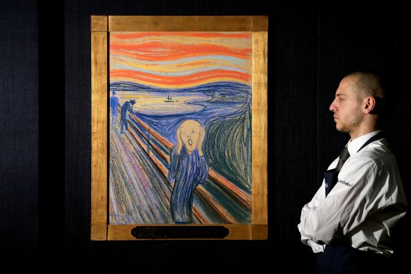 LONDON, ENGLAND - APRIL 12: A gallery technician at Sotheby's auction house views 'The Scream' by Edvard Munch on April 12, 2012 in London, England. The iconic painting is on public exhibition in London for the first time ahead of its auction in the 'Impressionist and Modern Art Evening Sale' at Sotheby?s New York on May 2, 2012 where it is expected to fetch in excess of 50 million GBP. (Photo by Oli Scarff/Getty Images)