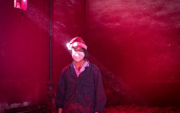Ronghui Chen/City Express, Operaio in un'industria di decorazioni natalizie in Cina