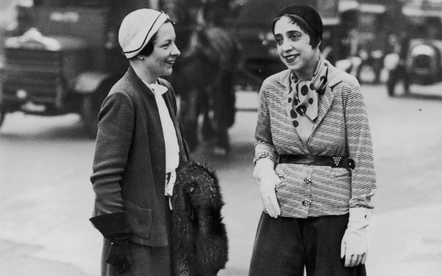 Innovative, witty Paris fashion designer Elsa Schiaparelli, right, in Hyde Park, London, wearing her 'trousered skirt' and illustrating her current fashion message: 'Trousers For Women!'   (Photo by Fox Photos/Getty Images)