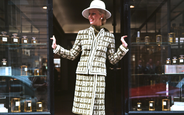 PARIS, FRANCE - JULY 21:  a model displays 21 July 1972 in Paris a striped woolen suit in automnal forest shades designed by Chanel for Autumn-Winter 1972/73 Haute-Couture collection  (Photo credit should read STAFF/AFP/Getty Images)