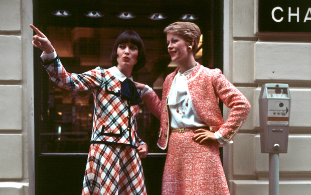 PARIS, FRANCE - JANUARY24:  models display 24 January 1977 in Paris : left, checked blue red and white woolen suit embroidered with a white cotton blouse with Claudine neck. At right, Pink and white tweed suit embroidered with a white wool brid worn with a white silk musslin blouse and tied neck designed by Chanel for Spring/Summer 1977 Haute-Couture collection  (Photo credit should read STAFF/AFP/Getty Images)