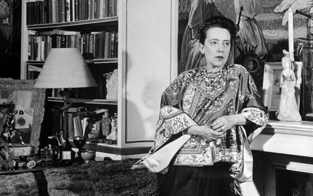 Madam Elsa Schiaparelli enjoying her study which is filled with treasures, paintings, and books.  (Photo by Hans Wild//Time Life Pictures/Getty Images)