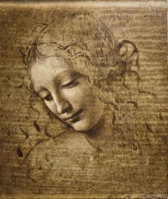 """Leonardo da Vinci, Testa di donna, detta """"La Scapiliata, (1504-1508 circa), terra ombra e ambra inverdita lumeggiata di biacca su tavola di pioppo; 24,7 x 21 cm, Galleria Nazionale di Parma"""