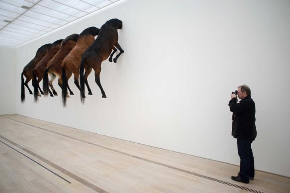 Cinque versioni di una stessa opera di Maurizio Cattelan esposte alla Fondazione Beyeler di Basilea nel giugno del 2013 (Photo by SEBASTIEN BOZON/AFP/Getty Images)