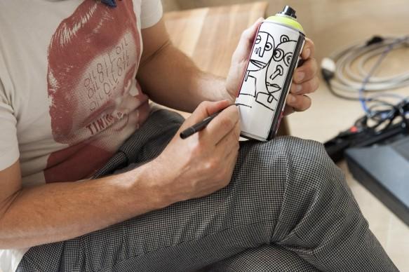 Una bomboletta spray disegnata e firmata da Jim Avignon durante la presentazione del programma di Sky Arte 'Muro', dedicato alla street art