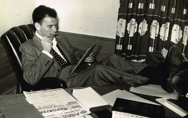 Frank Sinatra at desk, c. 1950