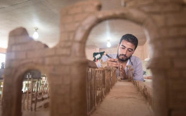 Mahmoud modello in miniatura Palmyra campo profughi siriani Giordania