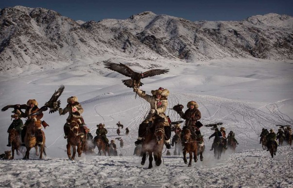 China's Kazakh Minority Preserve Culture Through Eagle Hunting in Western China © Kevin Frayer, Canada, Winner, Professional, Environment, 2016 Sony World Photography Awards