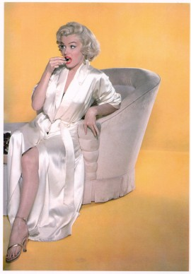 Marilyn Monroe wearing her satin robe from her movie wardrobe, here on a publicity still by John Florea. Photo: Collection Stampfer. Copyrights: John Florea
