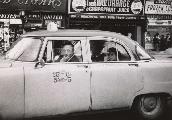 Diane Arbus, Taxicab driver at the wheel with two passengers, N.Y.C.  1956 © The Estate of Diane Arbus, LLC. All Rights Reserved