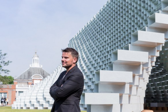 Architect Bjarke Ingels in front of the Serpentine Pavilion 2016 designed by Bjarke Ingels Group (BIG). Photo © Iwan Baan