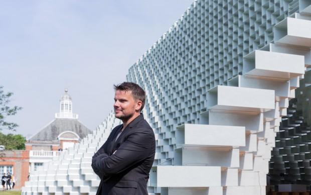 Architect Bjarke Ingels in front of the Serpentine Pavilion 2016 designed by Bjarke Ingels Group (BIG) Photo © Iwan Baan