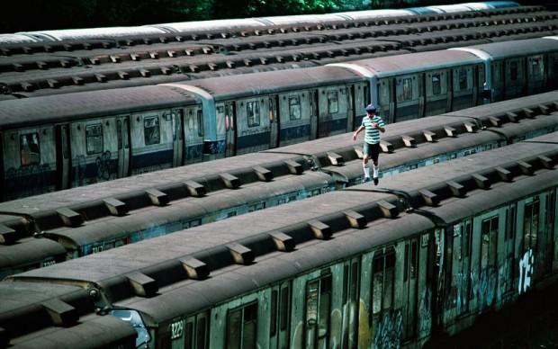 Boy Running on Top of Train, CC Yard, Bronx, NY, 1983 © Martha Cooper