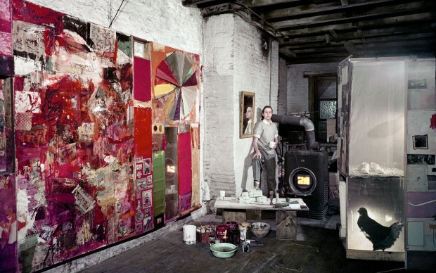 Rauschenberg in his Pearl Street studio, New York, March 1958. Works, left to right: Charlene (1954), Untitled (c. 1954), and a partial rear view of the second state of Monogram (1955–59, second state 1956–58). Photographer: Dan Budnik. Courtesy Robert Rauschenberg Foundation Archives, New York. © Dan Budnik, all rights reserved