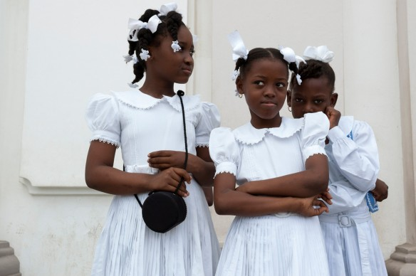 """Darren Ell (born in 1961), Haitian Girls in front of Notre-Dame Cathedral, Cap-Haïtien, Haiti, from the series """"Cap-Haïtien and Shada,"""" 2008, ink-jet print on adhesive vinyl, 1/1. Courtesy of the artist"""