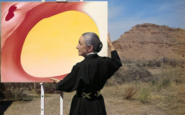 """Tony Vaccaro, Georgia O'Keefe with """"Pelvis Series, Red with Yellow"""" and the desert, 1960. Georgia O'Keeffe Museum. Courtesy of Tony Vaccaro studio."""