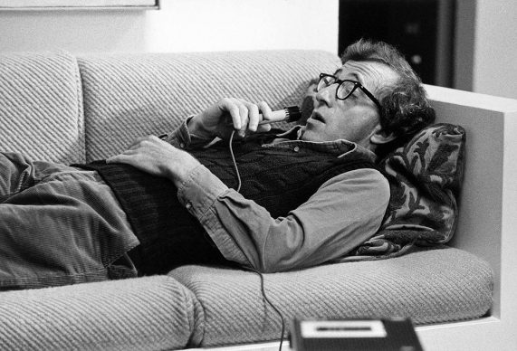 Woody Allen Speaking into a Recorder, Manhattan, NYC © Brian Hamill