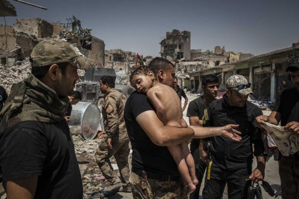 The Battle For Mosul - Young Boy Is Cared For By Iraqi Special Forces Soldiers, Ivor Prickett, Ireland per The New York Times