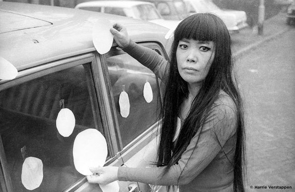 """Artist Yayoi Kusama next to her """"Dot Car"""" (1965) in KUSAMA - INFINITY. Photo credit: © Harrie Verstappen. Photo courtesy of Magnolia Pictures."""