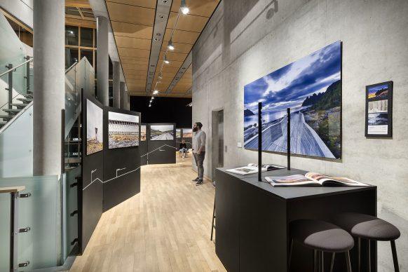 "Exhibition view. Bespoke table with Schluchtmann's book ""Architecture and Landscape in Norway"", edited by Hatje Cantz.  Photo credit: © Ken Schluchtmann -  diephotodesigner.de"
