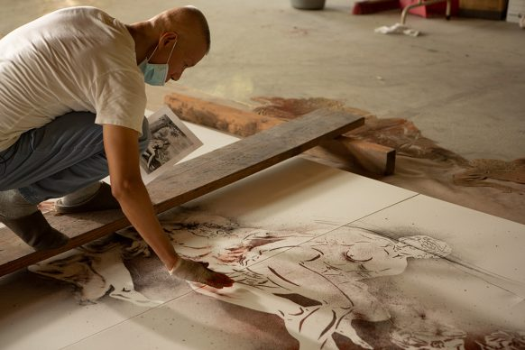 Cai Guo-Qiang during  the creation  of gunpowder painting  I  Modi, 2018  - Photo by Lin King,  courtesy Cai Studio
