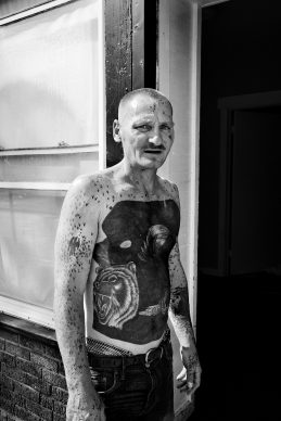 Paolo Pellegrin, A tattooed man in Northeast Rochester. Rochester, NY. U.S.A. 2012 © PAOLO PELLEGRIN/MAGNUM PHOTOS, 2012