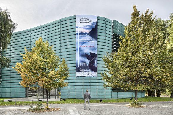 Large banner on the copper facade of the Nordic Embassies, Berlin, introducing the exhibition. Photo credit: © Ken Schluchtmann -  diephotodesigner.de