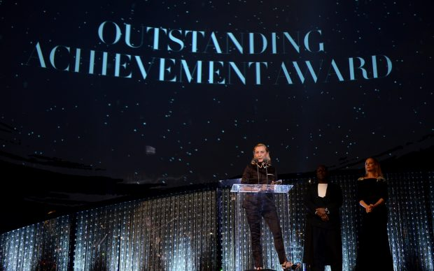 LONDON, ENGLAND - DECEMBER 10: (L-R) Miuccia Prada winner of Outstanding Achievement award on stage with Steve McQueen and Uma Thurman during The Fashion Awards 2018 In Partnership With Swarovski at Royal Albert Hall on December 10, 2018 in London, England. (Photo by Joe Maher/BFC/Getty Images)