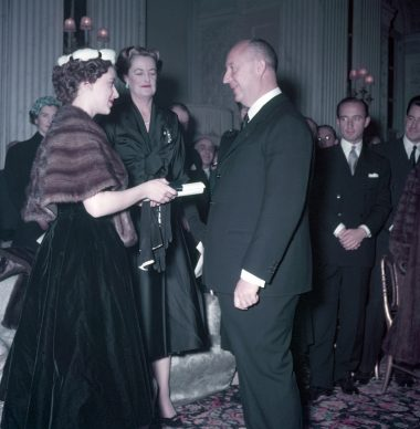 Princess Margaret presents Christian Dior with a scroll entitling him to Honorary Life Membership of the British Red Cross © Popperfoto, Getty Images