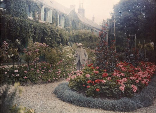 """Anonymous, """"Monet in His Garden at Giverny"""", 1921 - Autochrome 7 x 9 1/2 in. (17.8 x 24.1 cm) Collection of the Troob Family Foundation. Image courtesy of the Fine Arts Museums of San Francisco"""