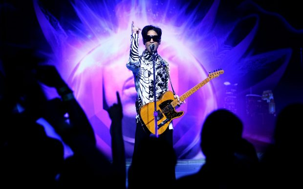 """LOS ANGELES, CA - MARCH 28: ***EXCLUSIVE*** Musician Prince performs his first of three shows onstage during """"One Night... Three Venues"""" hosted by Prince and Lotusflow3r.com held at NOKIA Theatre L.A. LIVE on March 28, 2009 in Los Angeles, California. (Photo by Kristian Dowling/Getty Images for Lotusflow3r.com)"""