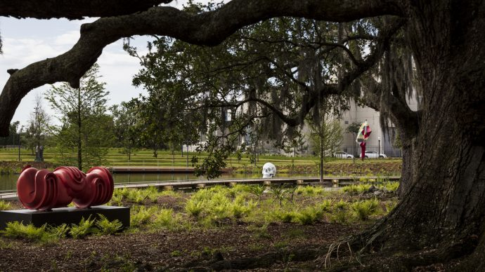 The Sydney and Walda Besthoff Sculpture Garden Expansion at the New Orleans Museum of Art, Left: Tony Cragg, Sinbad, 2000. Middle: Katharina Fritsch, Schädel/ Skull, 2018. Right: Yinka Shonibare, Wind Sculpture V, 2013. Photo Credit: Richard Sexton