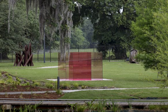 The Sydney and Walda Besthoff Sculpture Garden Expansion at the New Orleans Museum of Art. Left: Bernar Venet, 11 Acute Unequal Angles, 2016. Middle: Larry Bell, Pacific Red VI, 2016-17. Right: Hank Willis Thomas, History of the Conquest, 2017. Photo Credit: Richard Sexton
