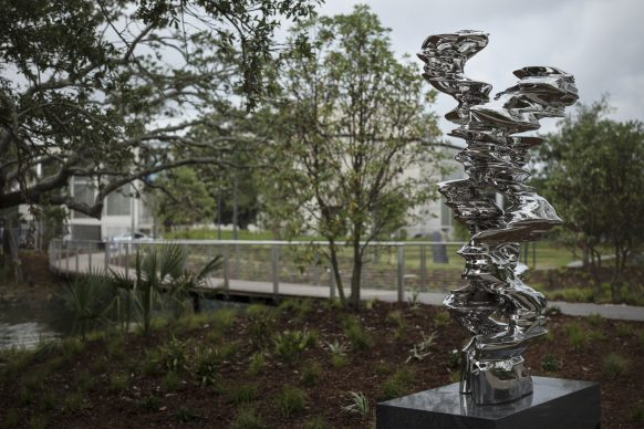 The Sydney and Walda Besthoff Sculpture Garden Expansion at the New Orleans Museum of Art, Pedestrian Pathway. Right: Tony Cragg, Runner, 2017. Photo Credit: Richard Sexton