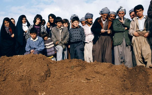 Susan Meiselas, Villagers watch exhumation at a former Iraqi military headquarters outside Sulaymaniyah, Northern Iraq, 1991 © Susan Meiselas, 2018