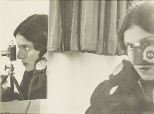 Self-portrait with Leica. Ilse Bing (1899–1998), 1931. Silver gelatine print, 19,5 x 21,5 cm, Thomas Walther Collection