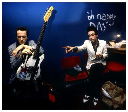 The Clash - Joe Strummer and Mick Jones  backstage in London. Photo Credit: © Adrian Boot