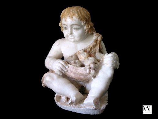 Statua in marmo raffigurante un Cupido seduto che indossa una pelle di animale piena di frutta, con tracce di policromia, 50 a.C.- 50 d.C., Pompei, Parco Archeologico di Pompei