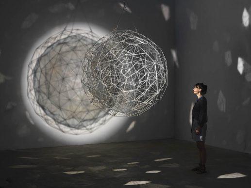 Olafur Eliasson, Stardust particle, 2014, stainless steel, translucent mirror-filter glass, wire, motor, spotlight, Ø 1760 mm, Tate. Photo: Jens Ziehe, 2017 © 2014 Olafur Eliasson