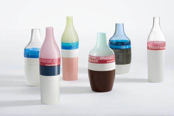 Hella Jongerius, Long Neck and Groove Bottles, 2000, porcelain, glass, plastic tape, Long Neck Bottle: h 50 x Ø 14 cm. Groove Bottle: h 44 x Ø 18 cm. Courtesy the artist © Gerrit_Schreurs
