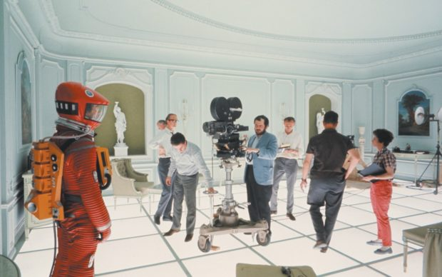 On the Hotel Room set of 2001: A SPACE ODYSSEY (1968, Dir. Stanley Kubrick). Kubrick is shown at center behind the camera. Credit: Courtesy of Warner Bros.