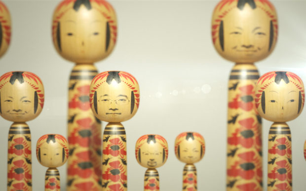 Visitors faces projected on to kokeshi dolls as part of the WOW: City Lights and Woodland Shade exhibition at Japan House London 21 November 2019 - 22 March 2020. Credit: Image by WOW