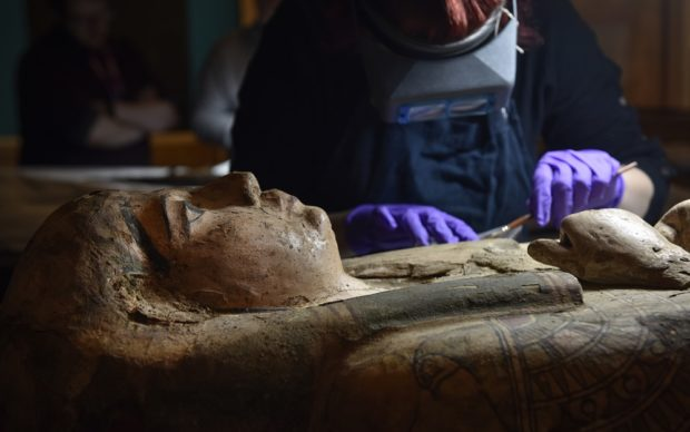 Conservators at Perth Museum and Gallery carefully clean a 3000 old mummy Ta-Kr-Hb, nicknamed the Perth Mummy, and her sarcophagus. Photo courtesy of the Perth Museum and Art Gallery, Scotland © Culture Perth & Kinross/Julie Howden