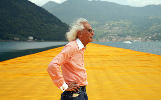 Lake Iseo, 2016. Christo at The Floating Piers. Photo: Wolfgang Volz © 2016 Christo