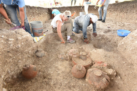 Daniela Triadan (center) excavating Cache NR4 (900-800 BC) with multiple ceramic vessels at Aguada Fénix. Credit Takeshi Inomata