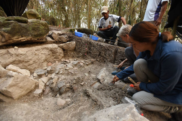 Melina Garcia (right) and Daniela Triadan excavating a ceramic deposit behind the megalithic structure of Aguada Fénix. Credit Takeshi Inomata