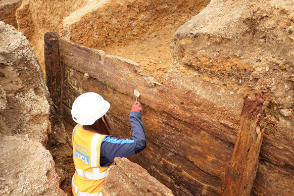 Archaeologists excavating the timber structure. Credit UCL Archaeology South-East