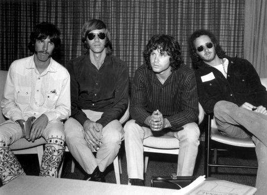 3rd September 1968:  American psychedelic rock band, The Doors during a press conference at Heathrow Airport, London (left to right); drummer John Densmore, keyboard player Ray Mansarek, vocalist Jim Morrison (1943 - 1971) and guitarist Robby Krieger.  (Photo by Central Press/Getty Images)