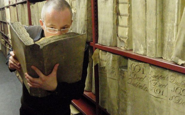 Prof. Matija Strlic smelling a historic book in the National Archives of The Netherlands © Matija Strlic