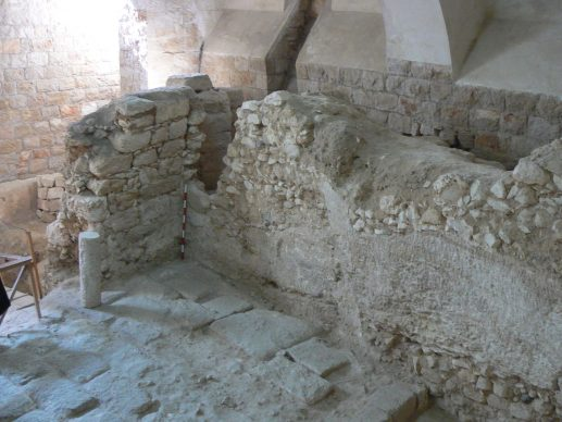 The first-century house, showing one of its rock-cut walls.The position of the scale indicates the line of a crusader-period vault later coverin. Copyright K. R. Dark
